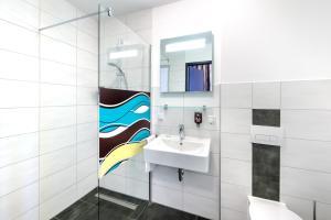 A bathroom at ibis Styles Arnsberg Sauerland