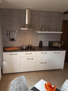 A kitchen or kitchenette at Le Studio by La Reine City Center