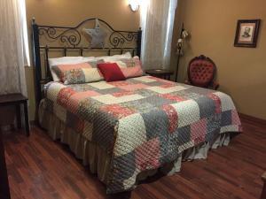 A bed or beds in a room at Virgil's Corner B & B