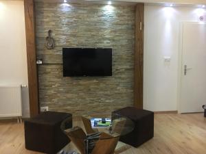 TV/Unterhaltungsangebot in der Unterkunft Studio cosy au centre de Couvet
