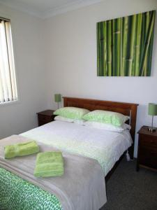A bed or beds in a room at River House Mudgee