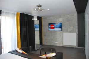 A television and/or entertainment centre at Le Durbuysien