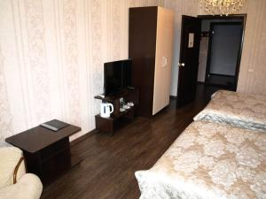 Телевизор и/или развлекательный центр в Motel Zebra