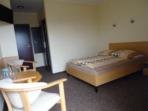 Łóżko lub łóżka w pokoju w obiekcie Willa Global