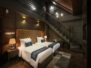 A bed or beds in a room at Aira Boutique Sapa Hotel & Spa