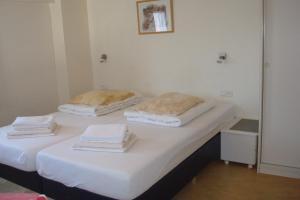 Un ou plusieurs lits dans un hébergement de l'établissement Hotel Rasch