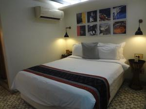 A bed or beds in a room at Abode Bombay