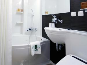 A bathroom at UNIZO INN Shin-Osaka