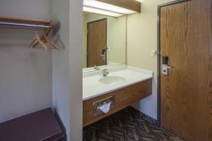 A bathroom at Super 8 by Wyndham Dwight