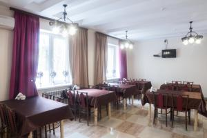 A restaurant or other place to eat at Hotel Alma Ata