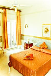 A bed or beds in a room at Hotel Palace Nardo