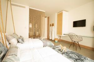 A bed or beds in a room at Aelia Wellness Retreat