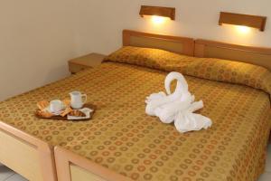 Letto o letti in una camera di Hotel La Filadelfia