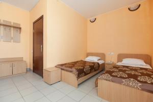 Кровать или кровати в номере Отель Регина Петровский