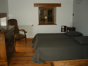 A bed or beds in a room at Ferme auberge briassou