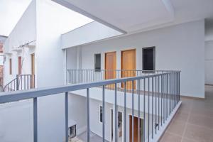 A balcony or terrace at UROOMS Tanah Abang