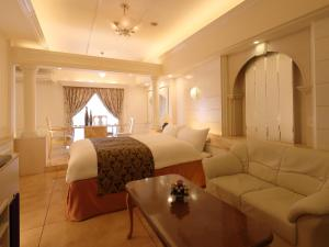 A bed or beds in a room at Hotel Fine Garden Nara Horai (Adult Only)