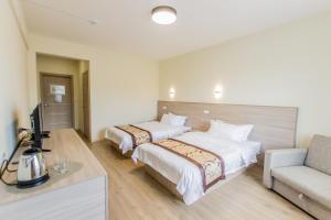 Кровать или кровати в номере Гостевой дом Baikal Holiday
