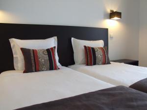 Uma cama ou camas num quarto em Casa Do Vale Hotel