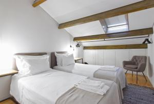 A bed or beds in a room at Casas do Rivoli