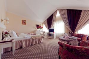 Кровать или кровати в номере Чехов Отель сети Оригинальные Отели
