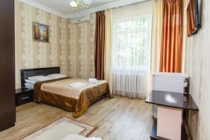 Кровать или кровати в номере Гостевой Дом Рената