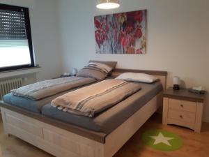 Ein Bett oder Betten in einem Zimmer der Unterkunft Charmant und stilvoll