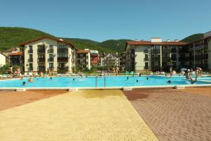 The swimming pool at or near Apartment on Lukomorya 1