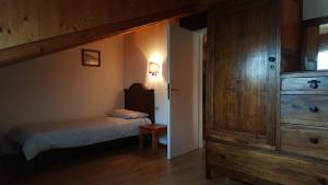 Cama o camas de una habitación en Trattoria Traversi