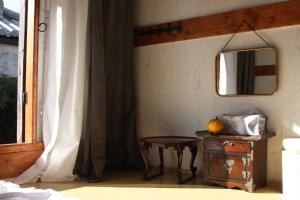 A television and/or entertainment center at Ginkgo Tree Guesthouse