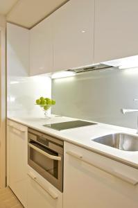 A kitchen or kitchenette at Fraser Residence City