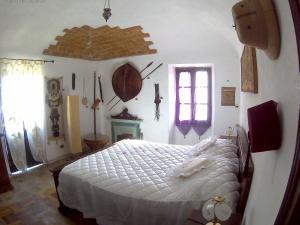 Letto o letti in una camera di Un Sogno nel Borgo