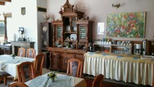 A restaurant or other place to eat at Penzion Harmonia