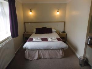 A bed or beds in a room at Wheyrigg Hall Hotel