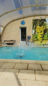 The swimming pool at or near Chambre d'Hotes de la Loge