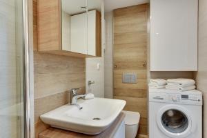 Łazienka w obiekcie Lion Apartments - Parkowa 33A