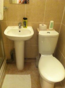 A bathroom at London Olympus Hotel