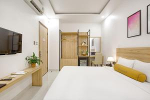 A bed or beds in a room at Continent Hotel Da Nang