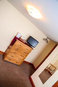 A television and/or entertainment center at Henshire B&B
