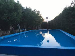 The swimming pool at or near Hotel Satelit Kumanovo