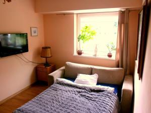 Łóżko lub łóżka w pokoju w obiekcie Studio Ewa