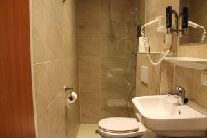 Ванная комната в Hotel Blossoms City