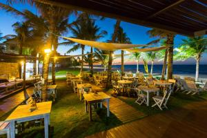 A restaurant or other place to eat at Vila Coqueiros Boutique Hotel