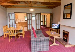 A seating area at Castlerosse Park Resort Holiday Homes