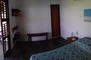 A bed or beds in a room at Pousada Vila Joanes