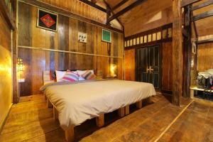 Un ou plusieurs lits dans un hébergement de l'établissement Mu Cang Chai Eco Lodge