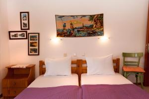 A bed or beds in a room at Mirsini Apartments