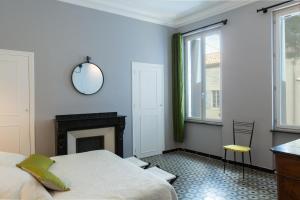 A bed or beds in a room at La Maison des Vendangeurs 2