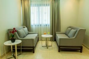 Uma área de estar em Baisan Suites Al Jubail