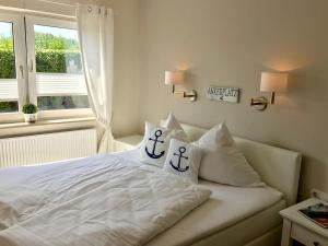 Ein Bett oder Betten in einem Zimmer der Unterkunft Hotel Ostsee-Anker
